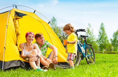 Young family enjoying a bicycle and camping holiday