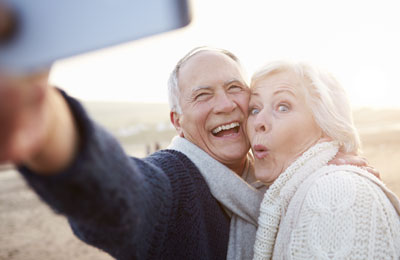 Couple taking a selfie on the coast