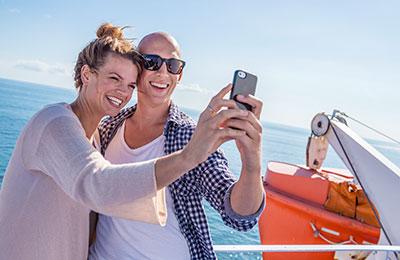 Couple on deck taking a selfie